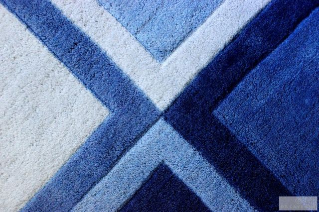 This rug has been with us since my son was 3.  I bought it at Target.It has so many blues to offer to future room changes. We could add green, or orange, or red, grey, you name it for future accent colors, which adds  the longevity I talk about in the article.