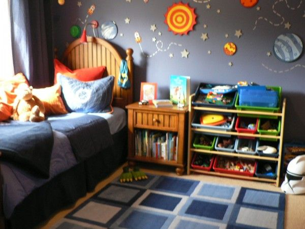 This is a not so great quality photo of my son s room at the toddler stage. Pinterest has the better shot but I can t  seem to track that one down. This room was really thrown together while I was 7 months pregnant with his sister, but has over 250 pins on Pinterest! It completely surprised me.  I made the planets out of foam core by hand. Serious nesting was happening.  Space rooms are a popular thing on Pinterest I guess!